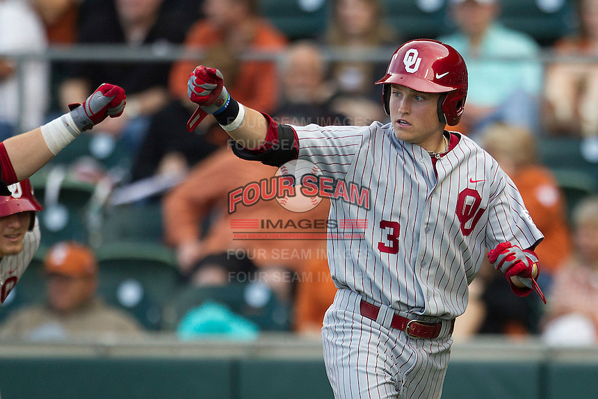 Oklahoma Sooners outfielder Craig Aikin #3 celebrates after scoring a run against the Texas Longhorns in the NCAA baseball game on April 5, 2013 at UFCU DischFalk Field in Austin Texas. Oklahoma defeated Texas 2-1. (Andrew Woolley/Four Seam Images).