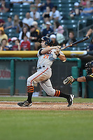 Gary Brown (21) of the Fresno Grizzlies at bat against the Salt Lake Bees at Smith's Ballpark on May 25, 2014 in Salt Lake City, Utah.  (Stephen Smith/Four Seam Images)