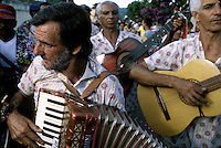 Musicians from one of Três Pontas' 19 Folia de Reis groups parade through the streets of the town in the state of Minas Gerais. A visit from a Folia is an honor upon the house.