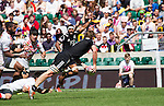 Scott Curry passes. All Blacks Sevens beat Japan 26-14. 16 May 2015. Twickenham, London, England. Photo: Marc Weakley