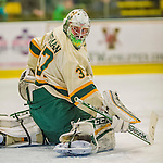 14 December 2013: University of Vermont Catamount Goaltender Brody Hoffman, a Sophomore from Wilkie, Saskatchewan, glances to the near corner in the third period against the Saint Lawrence University Saints at Gutterson Fieldhouse in Burlington, Vermont. The Catamounts defeated their former ECAC rivals, 5-1 to notch their 5th straight win in NCAA non-divisional play. Mandatory Credit: Ed Wolfstein Photo *** RAW (NEF) Image File Available ***