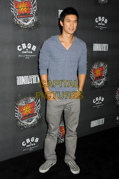 "HARRY SHUM JR..""Guitar Hero: Warriors of Rock"" Launch Party held at Paramount Studios, Hollywood, California, USA..September 27th, 2010.full length hands in pockets trousers grey gray blue v-neck top.CAP/ADM/BP.©Byron Purvis/AdMedia/Capital Pictures."