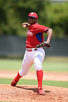 GCL Phillies pitcher Edubray Ramos (82) delivers a pitch before a game against the GCL Pirates on June 26, 2014 at the Carpenter Complex in Clearwater, Florida.  GCL Phillies defeated the GCL Pirates 6-2.  (Mike Janes/Four Seam Images)