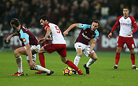 West Ham United's Mark Noble and West Bromwich Albion's Claudio Yacob<br /> <br /> Photographer Rob Newell/CameraSport<br /> <br /> The Premier League - West Ham United v West Bromwich Albion - Tuesday 2nd January 2018 - London Stadium - London<br /> <br /> World Copyright &copy; 2018 CameraSport. All rights reserved. 43 Linden Ave. Countesthorpe. Leicester. England. LE8 5PG - Tel: +44 (0) 116 277 4147 - admin@camerasport.com - www.camerasport.com