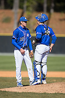 Saint Louis Billikens catcher James Morisano (26) has a chat on the mound with relief pitcher Mick Layton (52) during the game against the Davidson Wildcats at Wilson Field on March 28, 2015 in Davidson, North Carolina. (Brian Westerholt/Four Seam Images)