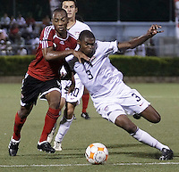 Kevin Mollno (7) battles for the ball against Anthony Wallace (3). US Under 20 Men's National Team played to a scoreless draw vs Trinidad & Tobago, advancing after winning 4-3 on penalty kicks in Macoya, Trinidad on March 13th, 2009...