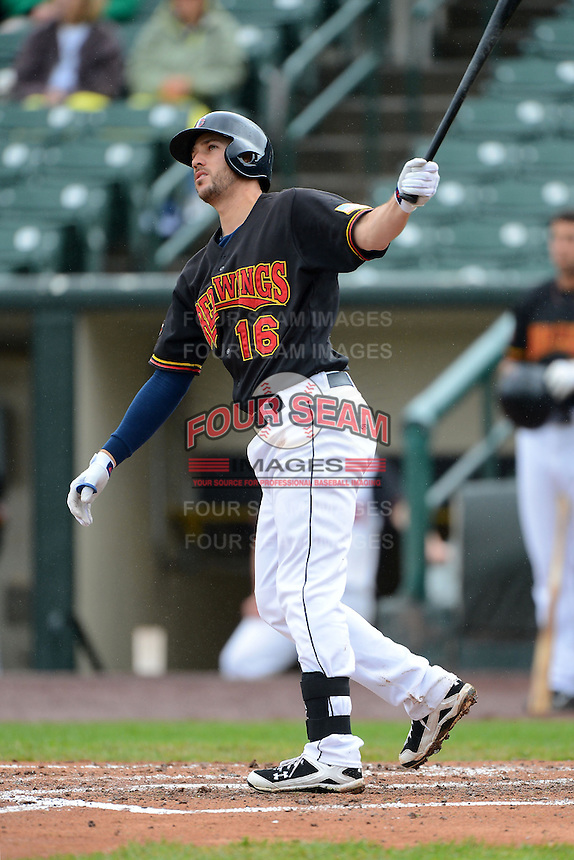 Rochester Red Wings third baseman Trevor Plouffe #16, on rehab from the Minnesota Twins, hits a home run during a game against the Toledo Mudhens on June 11, 2013 at Frontier Field in Rochester, New York.  Toledo defeated Rochester 9-5.  (Mike Janes/Four Seam Images)