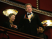 Actor Warren Beatty gestures to the crowd from the presidential box with wife, Annette Benning (L), prior to the start of the Kennedy Center Honors show December 5, 2004 in Washington, DC. Six honorees were saluted for their lifetime contributions to American culture through the performing arts.  His wife, Annette Bening is at left..Credit: Win McNamee - Pool via CNP