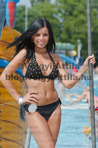 Evelin Szalai attends the Miss Bikini Hungary beauty contest held in Budapest, Hungary on August 06, 2011. ATTILA VOLGYI