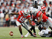 Ohio State Buckeyes cornerback Gareon Conley (19) goes after a fumble by Cincinnati Bearcats quarterback Jarred Evans (12) that ultimately gets back in the hands of the Bearcats in the first quarter of the college football game between the Ohio State Buckeyes and the Cincinnati Bearcats at Ohio Stadium in Columbus, Saturday afternoon, September 27, 2014. As of half time the Ohio State Buckeyes led the Cincinnati Bearcats 30 - 21. (The Columbus Dispatch / Eamon Queeney)