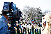 """First lady Michelle Obama reads """"Oh, the things you can do that are good for you!"""" a Dr. Seuss inspired book, to children during the 2015 Easter Egg Roll on the South Lawn of the White House, in Washington, DC on April 06, 2015.  The event features live music, sports courts, cooking stations, storytelling and Easter Egg Rolling.<br /> Credit: Aude Guerrucci / Pool via CNP"""