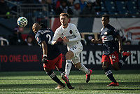 FOXBOROUGH, MA - MARCH 7: Andrew Farrell #2 of New England Revolution tackles Djordje Mihailovic #14 of Chicago Fire during a game between Chicago Fire and New England Revolution at Gillette Stadium on March 7, 2020 in Foxborough, Massachusetts.
