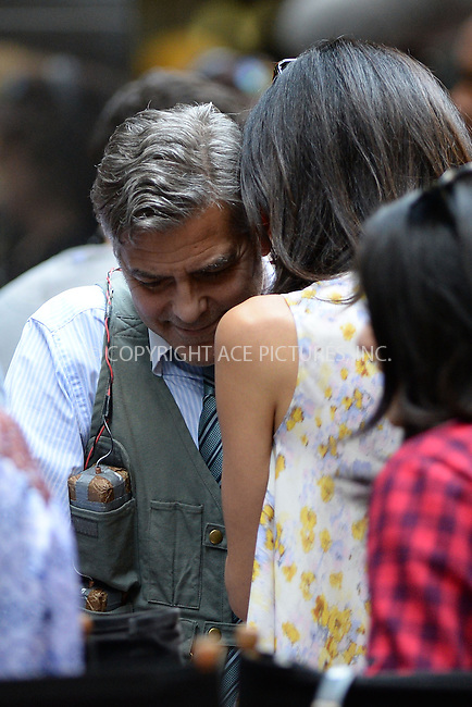 WWW.ACEPIXS.COM<br /> April 18, 2015 New York City<br /> <br /> George Clooney and Amal Clooney on the film set of 'Money Monster' in the Financial District of Manhattan on April 18, 2015 in New York City. <br /> <br /> By Line: Kristin Callahan/ACE Pictures<br /> ACE Pictures, Inc.<br /> tel: 646 769 0430<br /> Email: info@acepixs.com<br /> www.acepixs.com