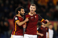 Calcio, Serie A:  Roma vs Palermo. Roma, stadio Olimpico, 21 febbraio 2016. <br /> Roma&rsquo;s Edin Dzeko, right, is hugged by teammate Mohamed Salah after scoring during the Italian Serie A football match between Roma and Palermo at Rome's Olympic stadium, 21 February 2016.<br /> UPDATE IMAGES PRESS/Riccardo De Luca