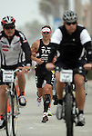 OCEANSIDE, CA- APRIL 2:  Winner Andy Potts of the USA runs during the Rohto Ironman 70.3 California in Oceanside, California on April 2, 2011. (Photo by Donald Miralle for LAVA Magazine) *** Local Caption ***