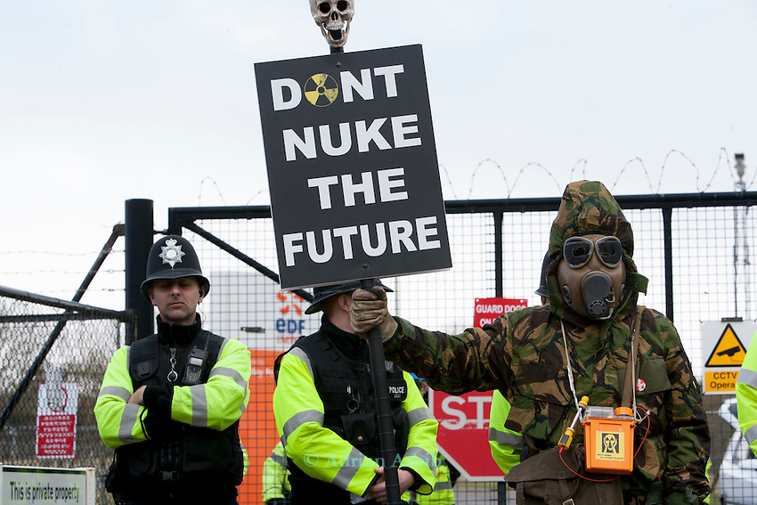 A masked protester  and a 'don't nuke the future ' placard at a march against the building of  Hinkley C power station, Somerset ,  and the UK government's choice of Nuclear power as the mainstay of England's power supply..Around 1000 people attended..10 thMarch 2012