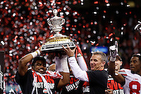 Ohio State Buckeyes head coach Urban Meyer and Ohio State Buckeyes running back Ezekiel Elliott (15) lift up the trophy after defeating the Alabama Crimson Tide in the Allstate Sugar Bowl and College Football Playoff Semifinal at Mercedes-Benz Superdome in New Orleans, Friday night, January 2, 2015. The Ohio State Buckeyes defeated the Alabama Crimson Tide 42 - 35. (The Columbus Dispatch / Eamon Queeney)