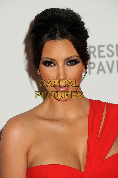"KIM KARDASHIAN .at LACMA's ""The Unmasking"" The Lynda & Stewart Resnick Exhibition Pavilion Opening Gala at The Los Angeles County Museum of Art in Los Angeles, California, USA, September 25th 2010..portrait headshot make-up beauty red one strap  shoulder  hair up   .CAP/ADM/BP.©Byron Purvis/AdMedia/Capital Pictures."