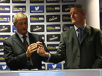 Scottish FA President Campbell Ogilvie (left) being handed a ball from Eddie Thompson, William Hill Operations Controller for Scotland, who drew the away teams in the draw for the Scottish Cup 1st Round which took place at Hampden Park, Glasgow on 8.8.13.