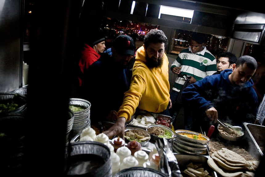 Street vendors prepare falaffel in New York City...(Matt Mills McKnight, 2008)