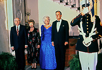 United States President George H.W. Bush, right, and President Mikhail Gorbachev of the Union of Soviet Socialist Republics, left, pose for a group photo with their wives in front of the Grand Staircase of the White House in Washington, DC prior to a state dinner  on Thursday, May 31, 1990.  From left to right: President Gorbachev, Raisa Gorbachev, first lady Barbara Bush, and President Bush.<br /> CAP/MPI/RS<br /> &copy;RS/MPI/Capital Pictures