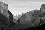 """The Valley"" Black and White. The entrance of Yosemite National Park's valley floor with El Capitan on the left, Half Dome in the middle and Bridalveil Waterfall on the right at sunset.  I was in Yosemite for a week in March and a week in April during the Spring of 2013. Due to the light winter snow fall I went earlier than normal to capture the waterfalls while they were still flowing pretty good. Sunsets in Yosemite really bring out the spectacular colors of the rock formations."