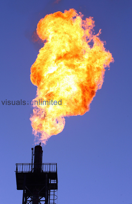 Unused gas burns from a flare bleeder in Petrochina Tazhong refinery, Tarim Oilfield, Xinjiang Province, China