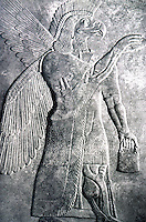 Assyria:  Eagle-headed Deity magically anointing a sacred tree, c. 875 B.C.  Nimrud, North West Palace.  (Photo '85.)