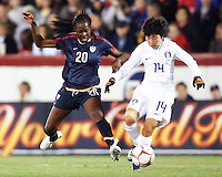 Tina Ellerton (20) of USA flies in to tackle Go Taehwa (14) of South Korea during an international friendly match at City Stadium on November 1, 2008 in Richmond, Virginia. USA won 3-1.