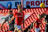 Barnsley's midfielder Joe Williams (4) heads wide during the Sky Bet Championship match between Barnsley and Leeds United at Oakwell, Barnsley, England on 25 November 2017. Photo by Stephen Buckley / PRiME Media Images.
