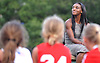 Crystal Dunn, a Rockville Centre native and 2016 US women's Olympic soccer team member, sits in front of members of the local youth soccer league during a ceremony honoring her at Hempstead State Park on Wednesday, July 13, 2016.