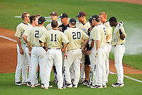 The Wake Forest Demon Deacons huddle around assistant coach Bill Cilento #37 prior to the game against the Miami Hurricanes at NewBridge Bank Park on May 25, 2012 in Winston-Salem, North Carolina.  The Hurricanes defeated the Demon Deacons 6-3.  (Brian Westerholt/Four Seam Images)