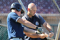 Lake County Captains outfielder Jordan Smith #39 works with hitting coach Jim Rickon #33 prior to the game against the Dayton Dragons at Fifth Third Field on June 25, 2012 in Dayton, Ohio. Lake County defeated Dayton 8-3. (Brace Hemmelgarn/Four Seam Images)