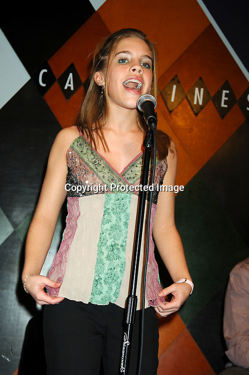 Kristen Alderson singing ..at The Launch of the One Life, Many Voices CD, ..which is a 26 Track compilation CD,comprised of original ..material, covers and spoken word. It was produced and sung by actors who star on One Life To Live and will  benefit Hurricane Relief. The event was on January 11, 2006 at Caroline's Comedy Club...Photo by Robin Platzer, Twin Images