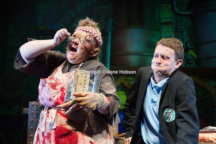 Horsham, West Sussex, UK. 20.09.2013. The Birmingham Stage Company presents HORRIBLE SCIENCE, from the book series by Nick Arnold, adapted for the stage by Mark Williams. Directed by Phil Clark. Lighting by Jason Taylor. Picture shows: Alison Fitzjohn (Monsterboy) and Iain Ridley (Billy Miller). Photograph © Jane Hobson.