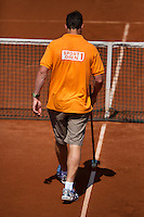 09-07-13, Netherlands, Scheveningen,  Mets, Tennis, Sport1 Open, day two, line sweeping<br /> <br /> <br /> Photo: Henk Koster