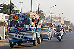 Colorfully painted buses roam the streets of Dakar, Senegal.