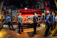 Young New York Fire Department firemen viewing exhibits, National September 11 Memorial & Museum, New York, New York USA.