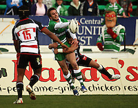 Manawatu winger Andre Taylor passes in the tackle of Sherwin Stowers during the Air NZ Cup rugby match between Manawatu Turbos and Counties-Manukau Steelers at FMG Stadium, Palmerston North, New Zealand on Sunday, 2 August 2009. Photo: Dave Lintott / lintottphoto.co.nz