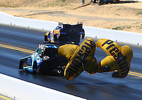 Jul. 26, 2014; Sonoma, CA, USA; NHRA funny car driver Jeff Diehl (near lane) races alongside Ron Capps during qualifying for the Sonoma Nationals at Sonoma Raceway. Mandatory Credit: Mark J. Rebilas-