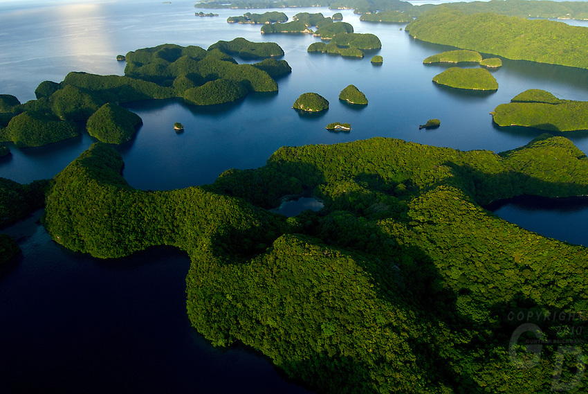 Aerial view of the Rock Islands in the late afternoon Natural Arch area Palau, <br /> Micronesia