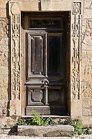 Typical old French doorway in the town of Les Eyzies in the Dordogne region of France
