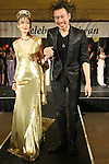 Taiwan based fashion designer, Alexander King Chen walks runway with Melody Young for the close of his Spring 2015 collection fashion show, for the Celebrate Taiwan event in Grand Central Terminal on September 27, 2014.