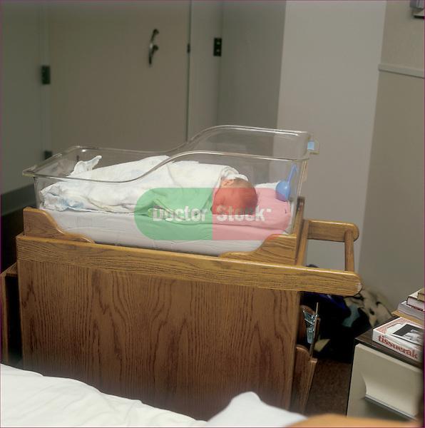 Newborn boy in hospital basinette