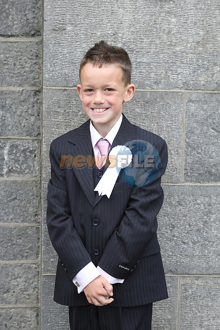 Ryan Donnelly at Slane NS Communion...(Photo credit should read Jenny Matthews www.newsfile.ie)....This Picture has been sent you under the conditions enclosed by:.Newsfile Ltd..The Studio,.Millmount Abbey,.Drogheda,.Co Meath..Ireland..Tel: +353(0)41-9871240.Fax: +353(0)41-9871260.GSM: +353(0)86-2500958.email: pictures@newsfile.ie.www.newsfile.ie.