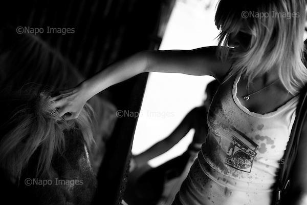 Wroclaw, Poland, April 4, 2009:<br /> Young woman visitor caressing a Shetland pony at the .Wroclaw Zoo, (Photo by Piotr Malecki / Napo Images)...Dziewczyna glaszcze kucyka szetlandzkiego w Zoo..Wroclaw, Kwiecien 2009.Fot: Piotr Malecki / Napo Images
