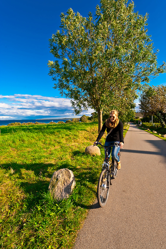 Women bicycling along the Baltic Sea between Boltenhagen and Gross Schwansee, Germany
