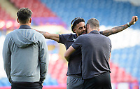 Lincoln City's Harry Toffolo, right, hugs team-mate Bruno Andrade prior to the game<br /> <br /> Photographer Chris Vaughan/CameraSport<br /> <br /> The Carabao Cup First Round - Huddersfield Town v Lincoln City - Tuesday 13th August 2019 - John Smith's Stadium - Huddersfield<br />  <br /> World Copyright © 2019 CameraSport. All rights reserved. 43 Linden Ave. Countesthorpe. Leicester. England. LE8 5PG - Tel: +44 (0) 116 277 4147 - admin@camerasport.com - www.camerasport.com