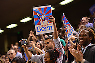"Baltimore, MD - April 23, 2016: A man records video and holds a sign that reads ""Feel the Bern"" as 2016 presidential candidate Sen. Bernie Sanders speaks during a campaign rally at the Royal Farms Arena in Baltimore, MD, April 23, 2016.  (Photo by Don Baxter/Media Images International)"
