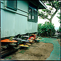 Surfboard under a house on the Northshore of Hawaii.